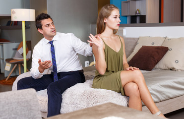Offended girl gesturing enough to apologizing husband