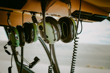 Communications Headsets In The Cockpit Of A Small Private Helicopter Preparing For Takeoff