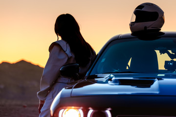 A Female Race Car Driver Watching The Sunrise Before Taking To The Track