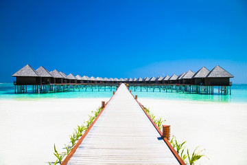 Beautiful tropical resort with wihte beach and turquoise water for relax on Olhuveli island, Maldives.