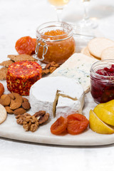 assortment of snacks, cheeses, nuts and fruits, vertical