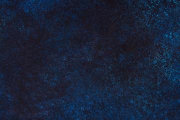 Dark blue slate background. Stone or concrete surface