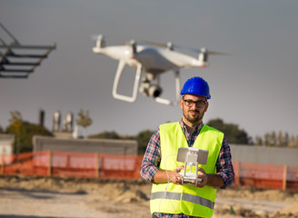 Engineer with drone at building site
