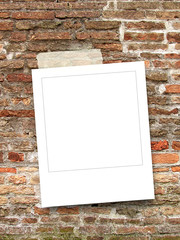 Blank square instant photo frame on old weathered brick wall background