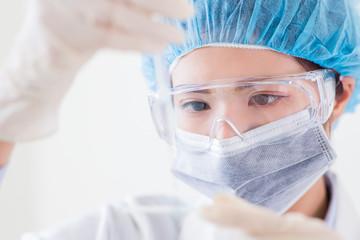 scientist take microscope slide