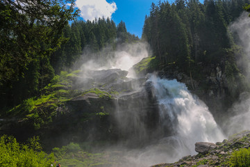 View Alpine inspiring Krimml waterfall in mountains in summer day. Trekking in National park Hohe Tauern, Austria
