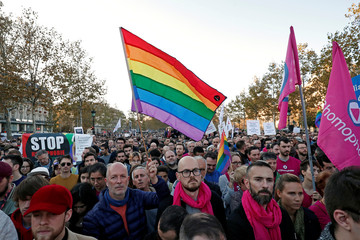 Members and supporters of the LGBT community protest against discrimination and violence, at the Place de la Republique in Paris