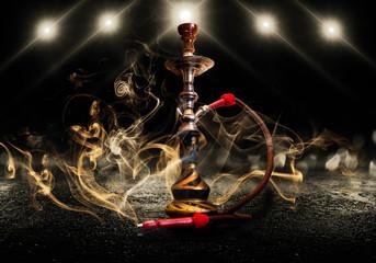 Hookah smoking on a dark concrete background, neon light, smog, night, rays
