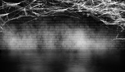 Cobweb in the basement against a brick wall at night, neon light, smoke, fog, concrete, smog. Halloween background