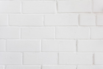 Neat white painted brick wall with a distinct texture