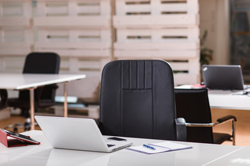 Office desk with a laptop, phone and tablet