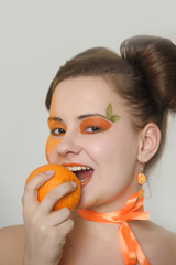 Beautiful girl with oranges. Portrait, female.
