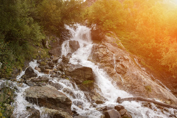 Closeup view waterfall scenes in mountains, national park Dombai, Caucasus, Russia, Europe. Summer...