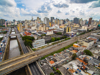 Great cities, great avenues, houses and buildings. Light district (Bairro da Luz), Sao Paulo Brazil, South America. Rail and subway trains. Aerial view of State Avenue next to the Tamanduatei River
