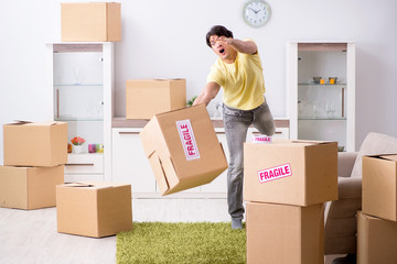 Man moving house and relocating with fragile items