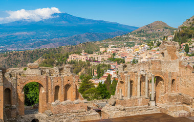 Ruins of the Ancient Greek Theater in Taormina with the Etna volcano in the background. Province of Messina, Sicily, southern Italy. Wall mural