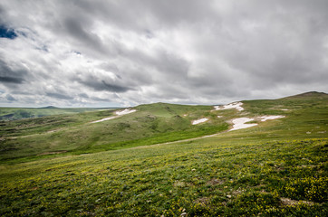 Beautiful tundra along the Beartooth Highway Pass in Monana on a summer day. Snow on the ground in patches