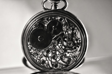 Skeleton of vintage handmade pocket watches, winter time and summer time concept, selective focus.