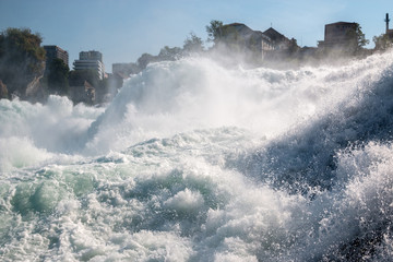 The Rhine Falls is the largest waterfall in Europe in Schaffhausen, Switzerland. Summer day with sun