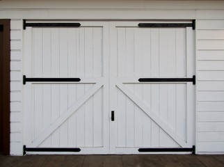 White wooden barn doors with black hinges