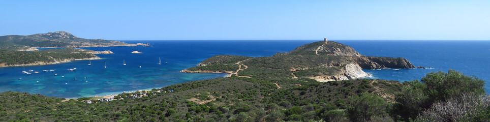 Great panoramic view of the blue bay and rugged coastline at Capo Malfatano, Sardinia, Italy