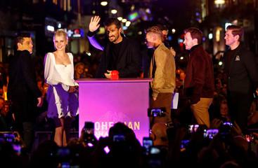 "Actors Rami Malek, Lucy Boynton, Ben Hardy, Joe Mazzello and Gwilym Lee attend the switch-on ceremony of a light installation in celebration of the film ""Bohemian Rhapsody"", in London"