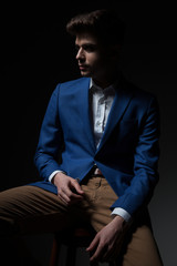 attractive smart casual man relaxing and looking to side
