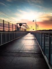 bridge in gothenburg sweden with rising sun in the pink sky