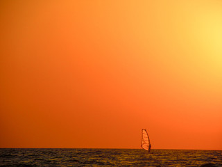 Wind surfer during sunset