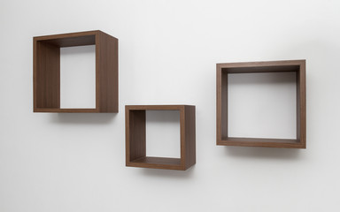 Wooden Shelves set on white wall
