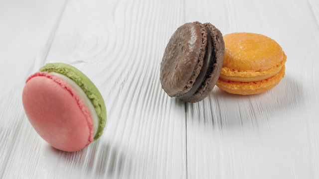 French macrons on white wooden table