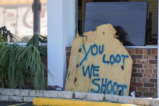 looting warning get shot sign