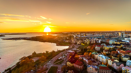 Aerial sunset view of beautiful city Helsinki . Colorful sky and colorful buildings. Helsinki, Finland.