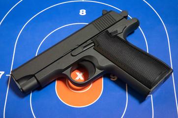 Hand Gun on Paper Target