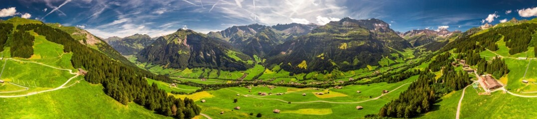 Aerial view of Elm village and Swiss mountains - Piz Segnas, Piz Sardona, Laaxer Stockli from Ampachli, Glarus, Switzerland, Europe