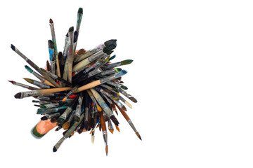 Paint brushes in a jar - view from above, isolated on white background with space for text