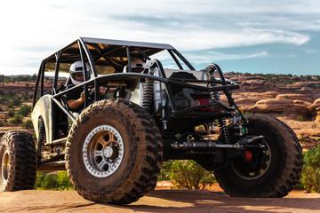 A Custom 4x4 Rock Crawler Off-Roading In The Sandstone Red Rock Terrain Outside Of Moab Utah In The American Southwest Wall mural