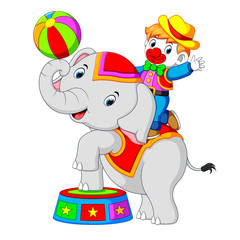 a boy uses a clown costume with an elephant while playing circus