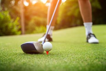 Golf ball on green grass ready to be struck