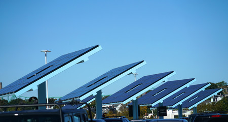 arrayed solar panels in a row in the parking lots