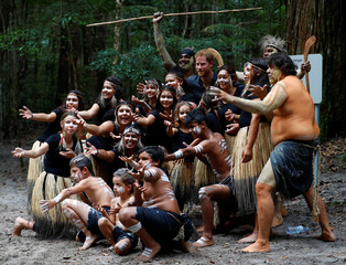 Britain's Prince Harry takes a photo with Butchulla People during a dedication ceremony of the forests of K'gari to the Queen's Commonwealth Canopy on Fraser Island in Queensland