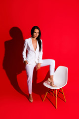 Posing snap portrait of skinny fit woman putting leg on chair lo