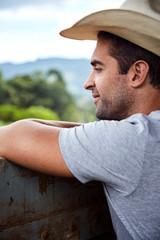 Thoughtful cowboy looking away