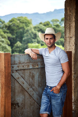 Portrait of cowboy posing in stable