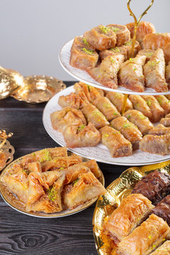 baklava with pistachio. turkish traditional delight on a dark wood background