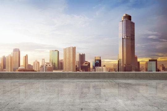 Empty rooftop floor with skyscrapers view