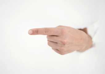 man's hand breaking through the paper wall and pointing at you