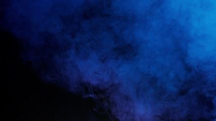 blue bomb smoke on black background