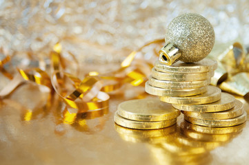 new year decorations on shining background with copy space with gold chocolate coins, Christmas background, Welth and health new year concept
