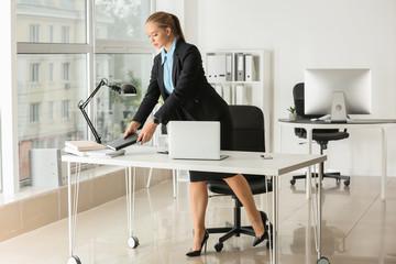 Beautiful female secretary working in office